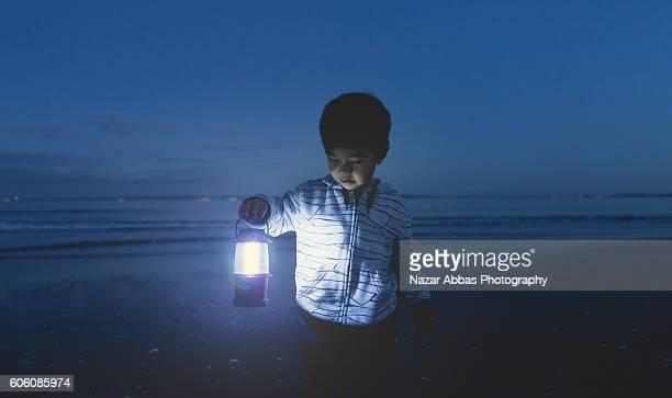 Boy Holding Lamp.