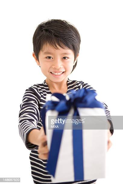 Boy holding out gift box