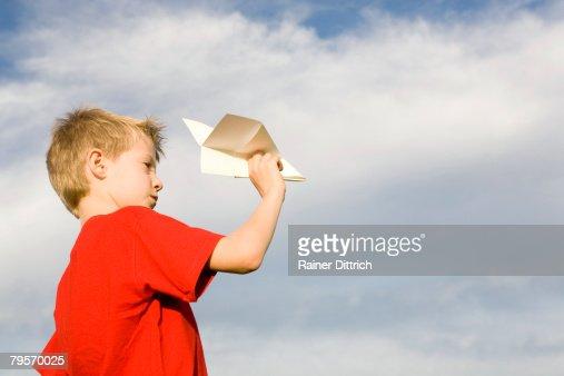 boy holding paper plane side view stock foto getty images. Black Bedroom Furniture Sets. Home Design Ideas