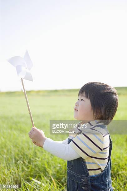 Boy holding pinwheel