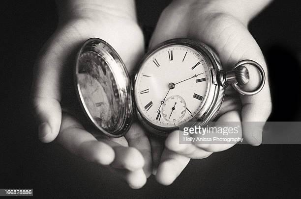 Boy Holding Pocket Watch