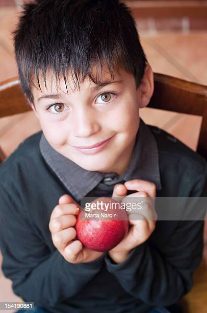 Boy holding re apple