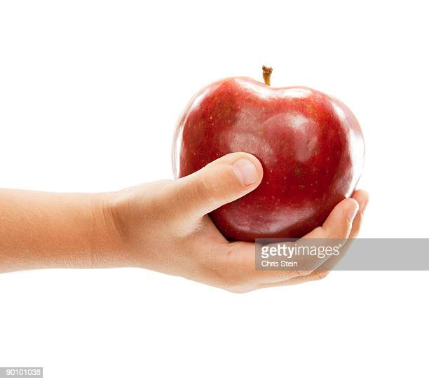 Boy holding red apple