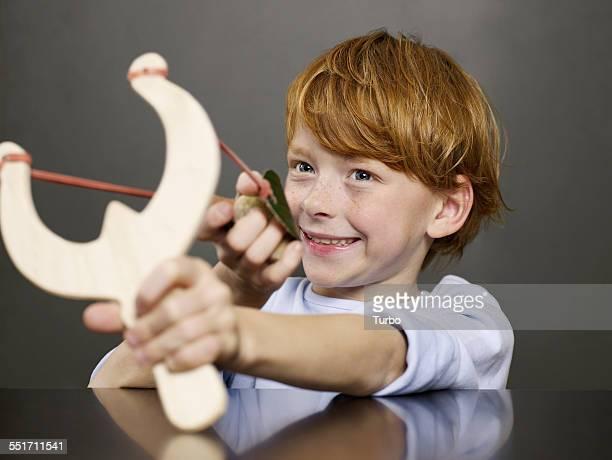 Boy Holding Slingshot