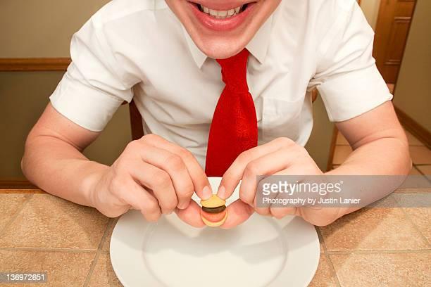 Boy holding small burger