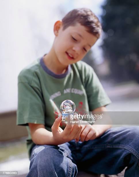 Boy holding snowglobe