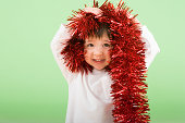 Boy holding tinsel