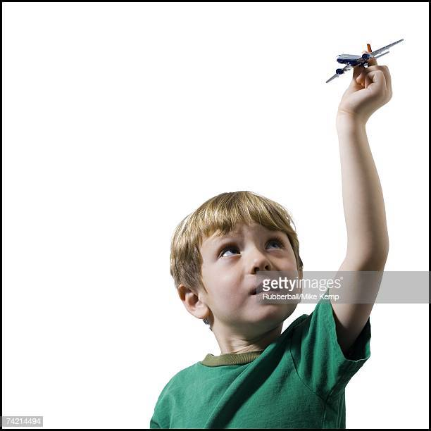 Boy holding toy airplane