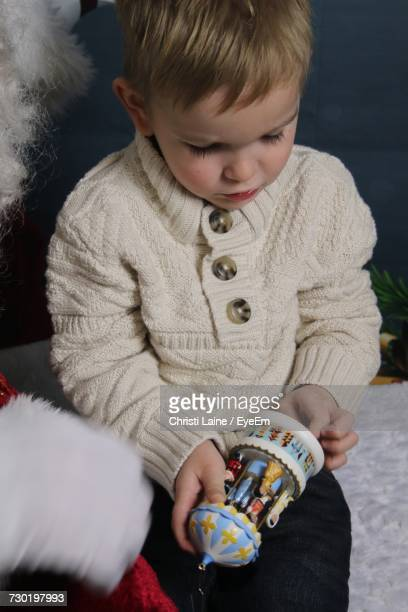 Boy Holding Toy During Christmas