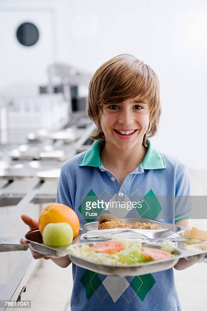 Boy Holding Tray in Cafeteria