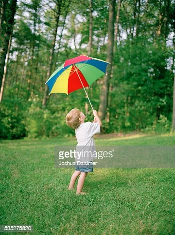 Boy holding umbrella : Stock Photo