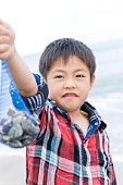 Boy holding up clams
