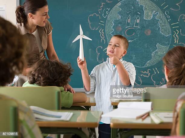 Boy holding wind turbine