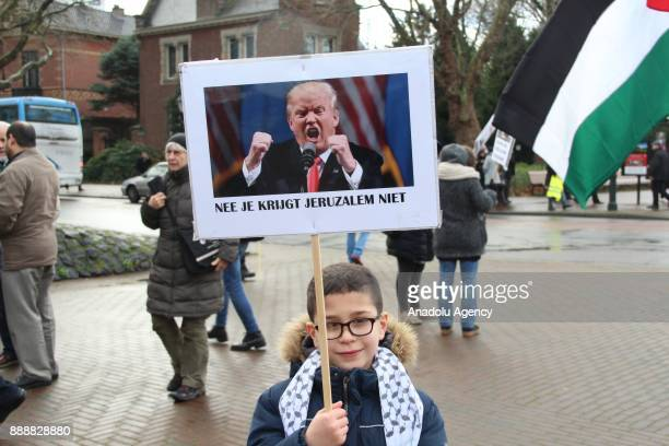 A boy holds a banner during a protest against US President Donald Trump's announcement to recognize Jerusalem as the capital of Israel and plans to...