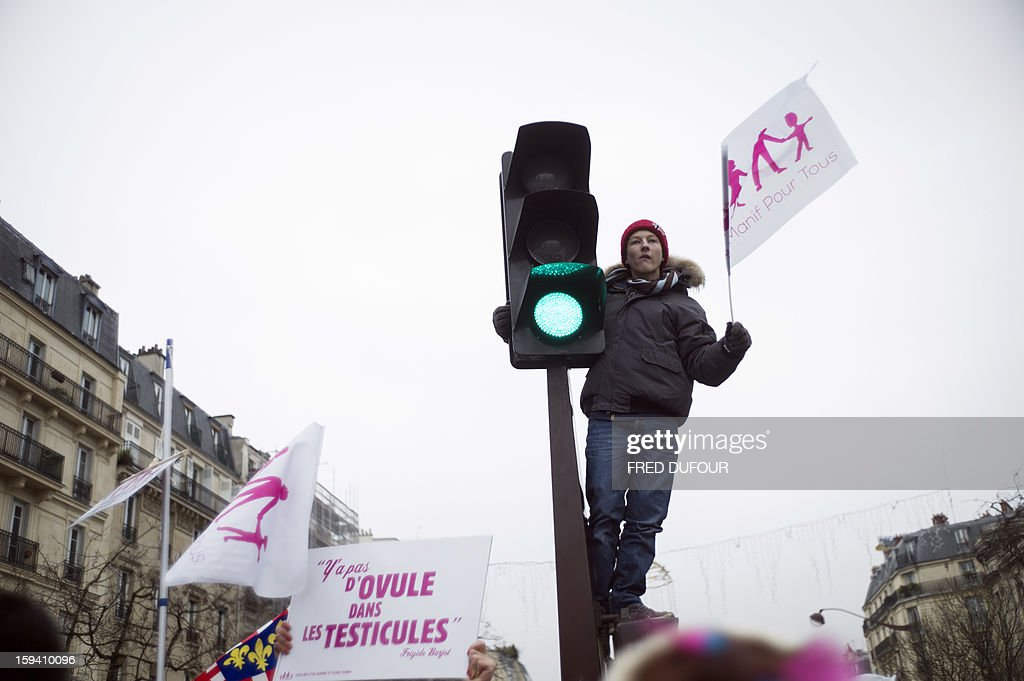 A boy holds a flag during a march against same-sex marriage on January 13, 2013 in Paris. Tens of thousands march in Paris on January 13 to denounce government plans to legalise same-sex marriage and adoption which have angered many Catholics and Muslims, France's two main faiths, as well as the right-wing opposition. The French parliament is to debate the bill -- one of the key electoral pledges of Socialist President -- at the end of this month.