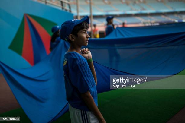 Boy holds a flag prior the FIFA U17 World Cup India 2017 group A match between Mali and New Zealand at Jawaharlal Nehru Stadium on October 12 2017 in...