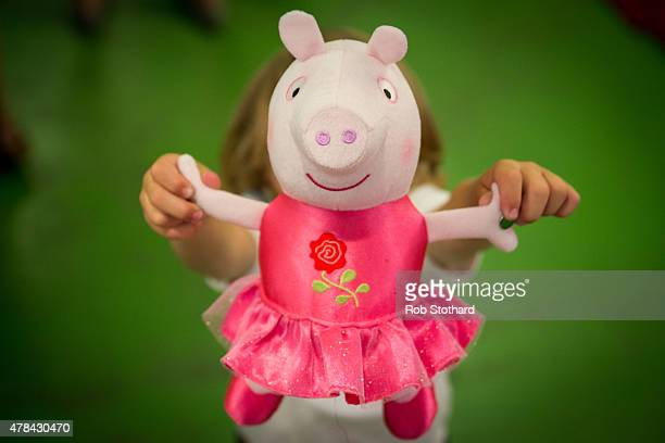 A boy holds a 'One Upon A Time Princess Rose' Peppa Pig toy at Hamleys on June 25 2015 in London England This Peppa Pig which will sing by having its...