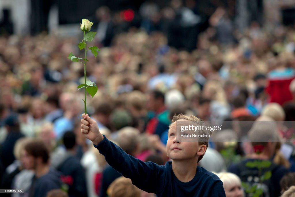 A boy holds a rose as thousands of people gather at a memorial vigil following Friday's twin extremist attacks on July 25 ,2011 in Oslo, Norway. Anders Behring Breivik, 32, claimed that he has 'two more cells' working with him as he appeared in court today following a bomb blast at a government building in Oslo and a shooting massacre on nearby Utoya Island that killed at least 76 people in all. The death toll was originally reported as 93. Breivik has been detained for eight weeks, four of which in full isolation.