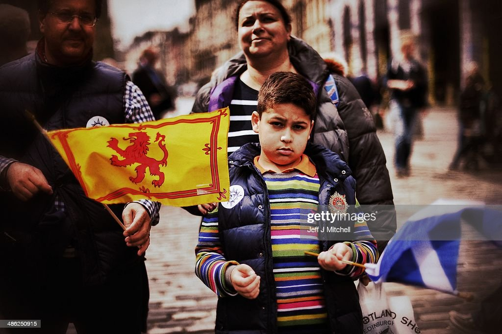 A boy holds a Saltire and Loin Rampant flag on April 23, 2014 in Edinburgh, Scotland. A referendum on whether Scotland should be an independent country will take place on September 18, 2014.