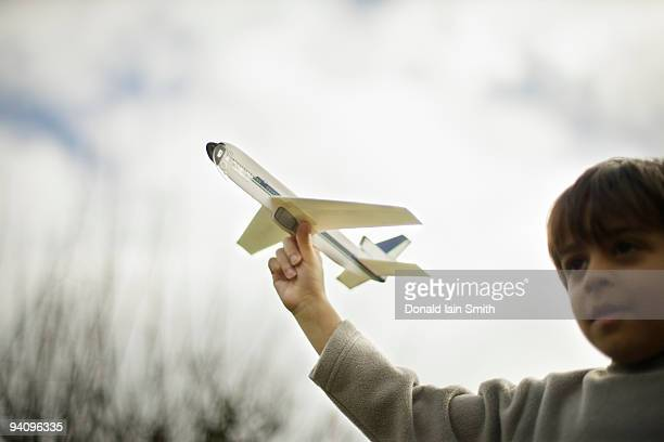 Boy holds model plane