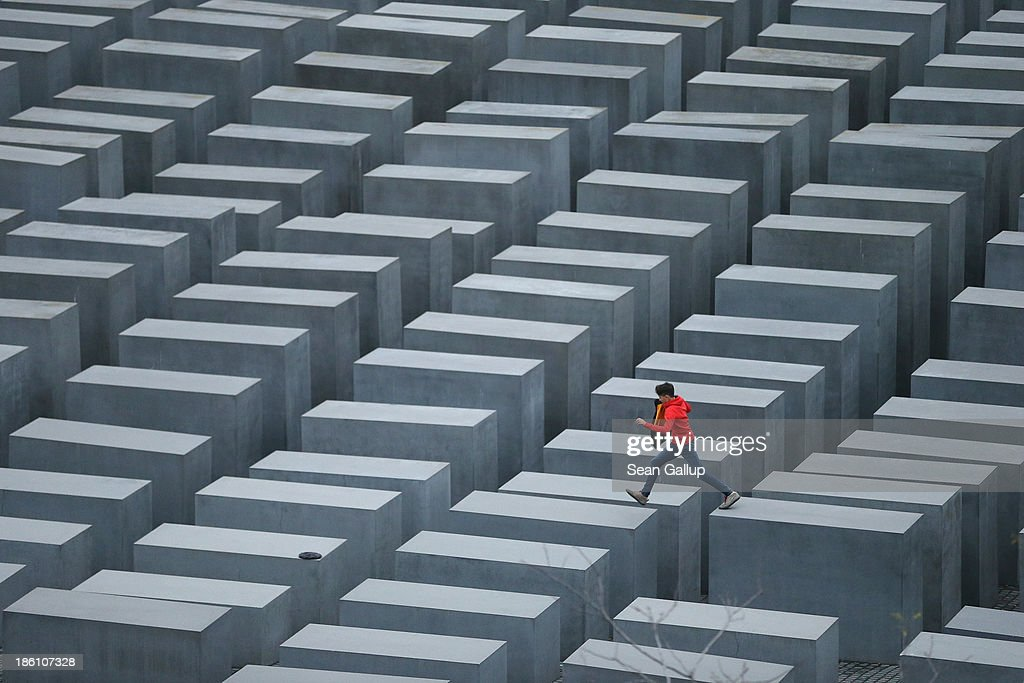 A boy hops from one to another of the 2711 stellae at the Memorial to the Murdered Jews of Europe also called the Holocaust Memorial on October 28...