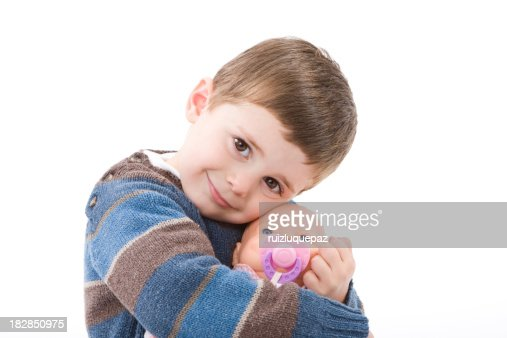 Boy hugging a doll