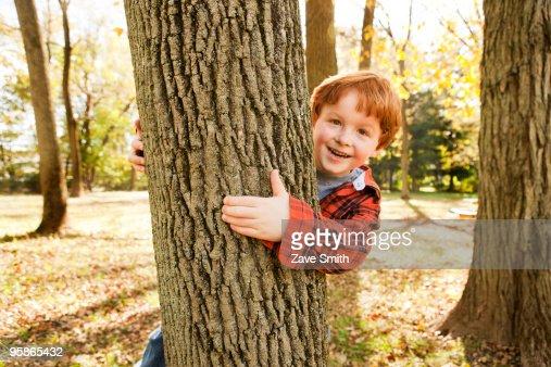 boy hugging a tree : Stock Photo
