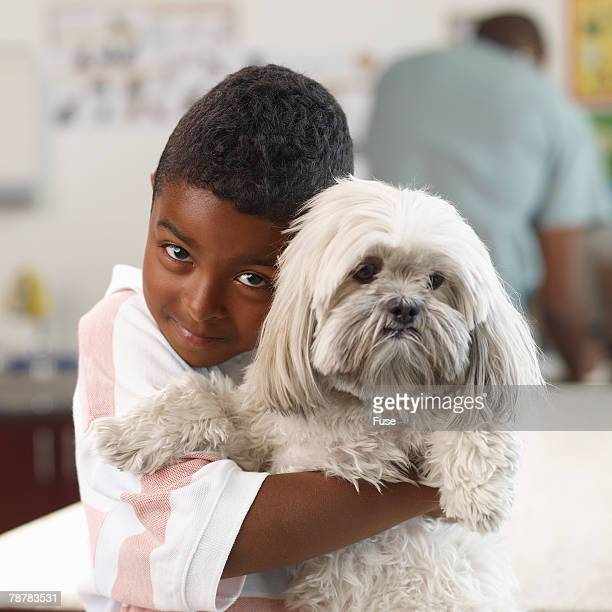 Boy Hugging Dog in Veterinarians Office