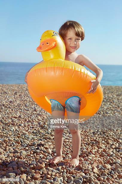 Boy hugging duck shaped float