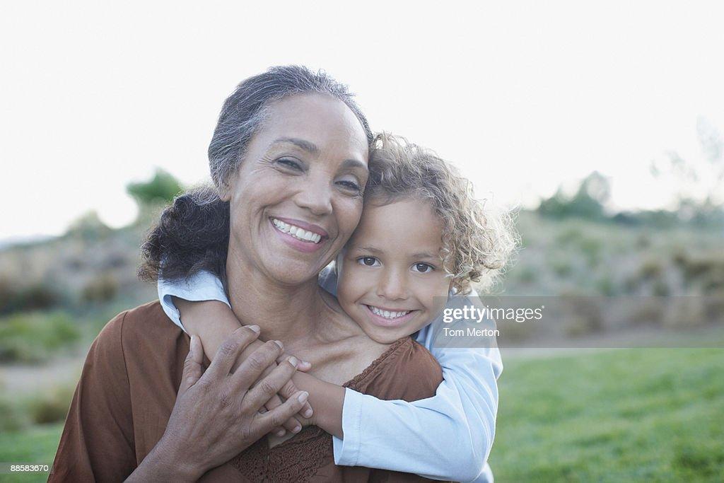 Boy hugging grandmother : Stock Photo