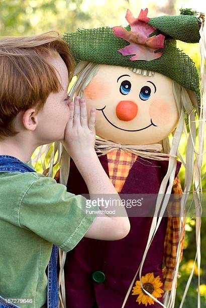 Boy Imagines Friendship with Autumn Scarecrow, Redhead & Freckles Child