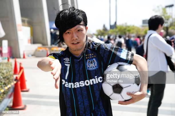 A boy imitates Yasuhito Endo before the JLeague J1 match between Cerezo Osaka and Gamba Osaka at Yanmar Stadium on April 16 2017 in Osaka Japan