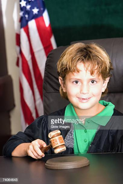 Boy imitating a judge in a courthouse