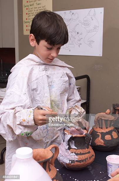 Boy In 6Th Grade Glazing Pottery