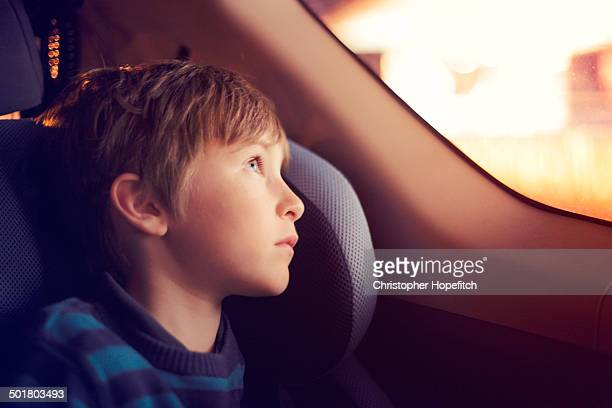 Boy in a car at night