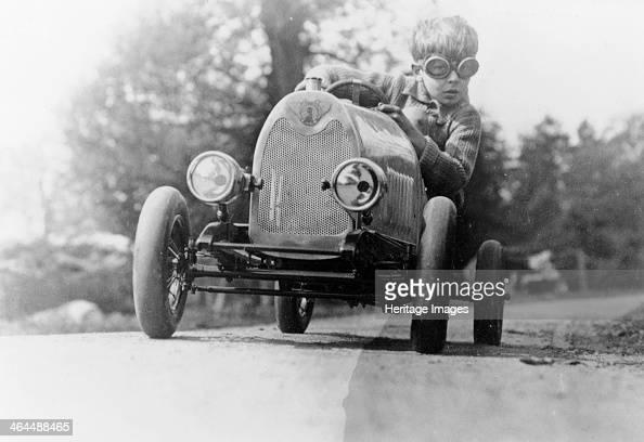Boy in a pedal car The boy in the pedal car is Gordon Crosby's son