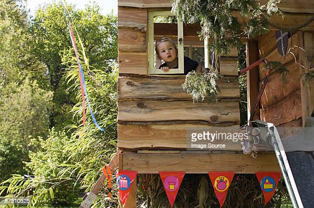 Boy in a treehouse
