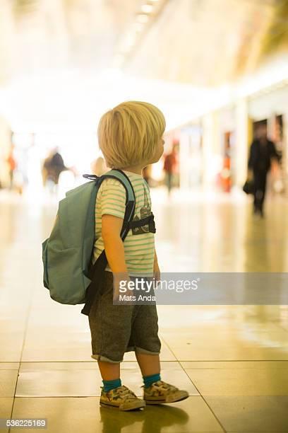 Boy in airport looking away..