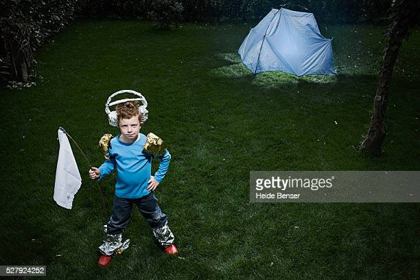 Boy (7-9) in astronaut costume