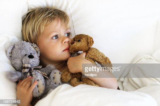 Boy in bed : Stock Photo
