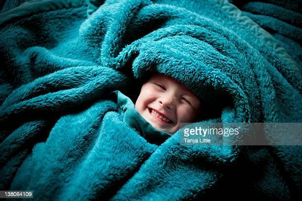 Boy in blanket