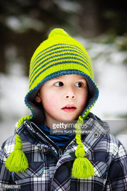 Boy in bright green snow cap