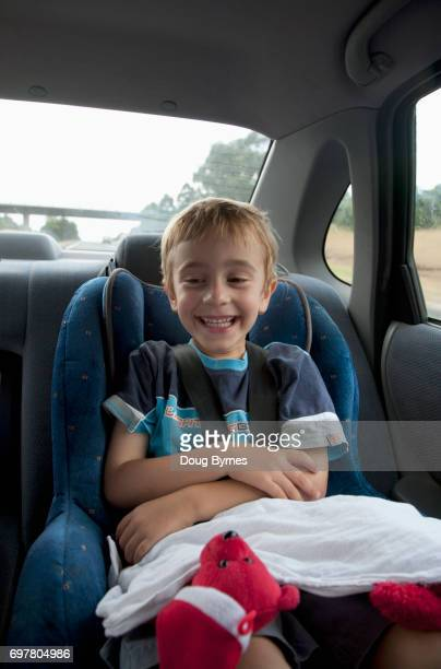 Boy in car seat on trip