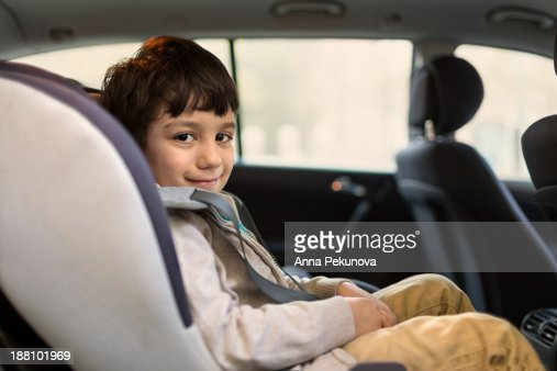 Boy in child safety seat looking at camera