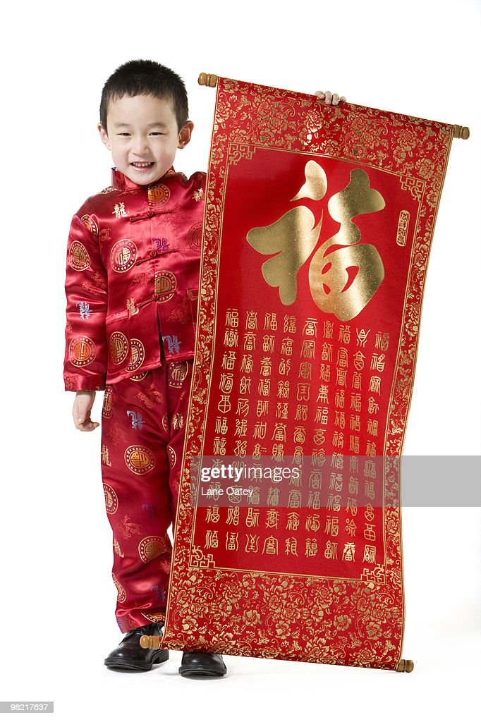 boy in chinese traditional clothes holding chinese new year scroll stock photo getty images. Black Bedroom Furniture Sets. Home Design Ideas
