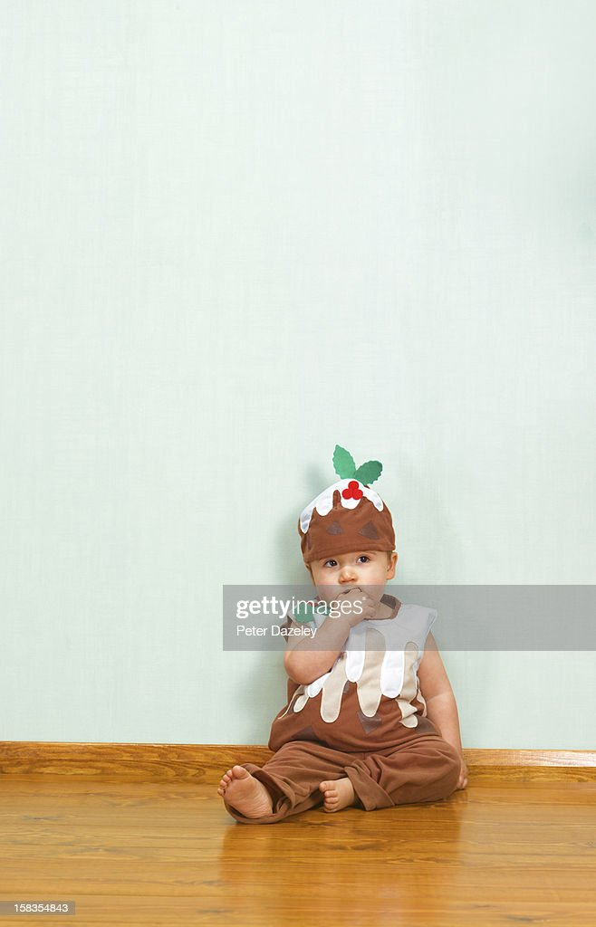 Boy in christmas pudding outfit with copy space : Stock Photo