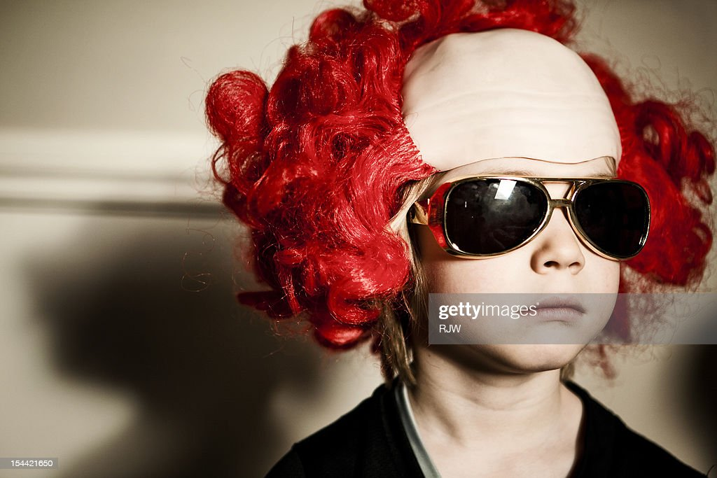 Boy in Clown Wig and Evis Glasses : Stock Photo