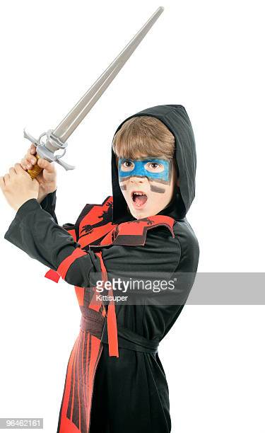 Boy in costume ninja and with a sword