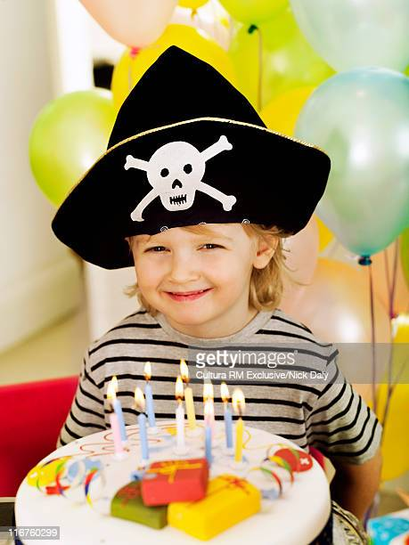 Boy in costume with birthday cake