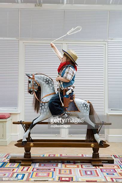 Boy in cowboy costume with lasso